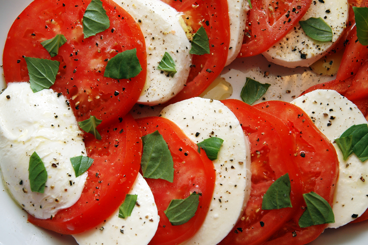 Sliced tomatoes, fresh mozzarella, drizzled olive oil, shredded fresh basil, salt, pepper... my favorite salad!