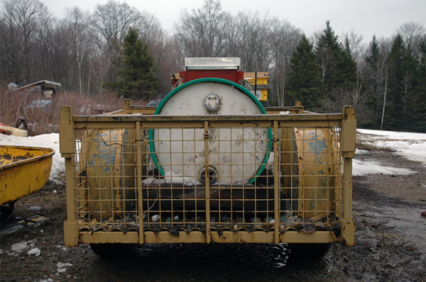 This is the trailer vat. It is connected to the back of a 4-wheeler traveling the trails of tapped trees and carries the cumulative collected sap back to the sugar shack.