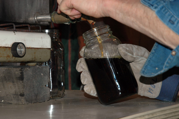 Through one last filter, the now maple syrup remains on a consistent heat using bunsen burners and pours easily at about 100° C into sterilized mason jars. The high heat of the syrup will seal the jars without the need for boiling.