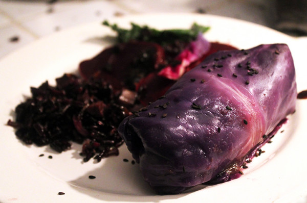 The black bean cabbage roll special with poppy seed rice pilaf and black root salad.