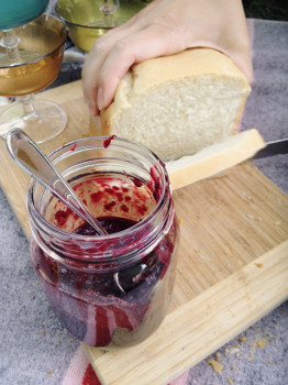 cutting bread with compote