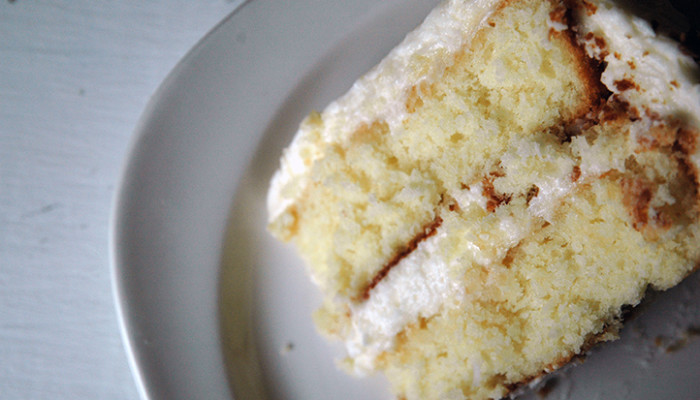 See how moist and large that cake crumb is? Perfection; that's what using cake flour and buttermilk and folding the ingredients together gently will get you.