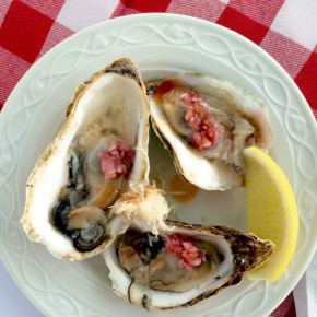 Fresh oysters with a red wine vinaigrette, shaved horseradish and a dash of tabasco